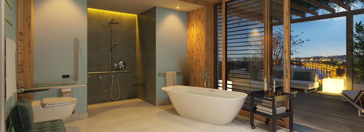 Ein großzügiges, modernes Bad, links eine Toilette, im Hintergrund eine barrierefreie Dusche in einer Nische, eine freistehende Badewanne im Vordergrund.